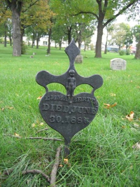 """""""The babies [from the Baby Farm on Nicollet Avenue] are buried in unmarked graves at various locations throughout the cemetery."""" This heart shaped grave marker is for Emma Bertta who died June 30th 1886, marker of a heart shaped cross and whose family did provide this marker."""