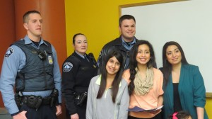 Daisy and family members with three officers from the 3rd Police Precinct at the Backyard Initiative's All CHAT meeting present to recognize the valiant efforts of Daisy and her family. From left to right- backrow; Sgt. Carrol, Officer Turner, and Officer Hakanson. Front Row; Fifi, Daisy, and Kathy Buenrostro.